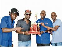 Alaska owner KiKi (second left), poses with the winning trophy with selectors (from left) Killa and Clarksie and Road Manager, Kernel.