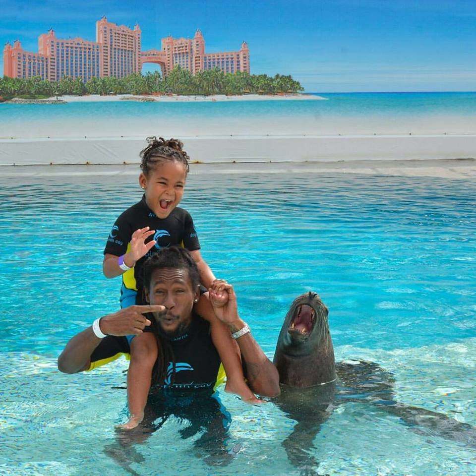 Jah Cure And His Daughter Having Fun At Dolphin Cay