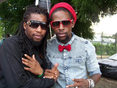 Don Zee and Jah Cure pose for a pic after performing