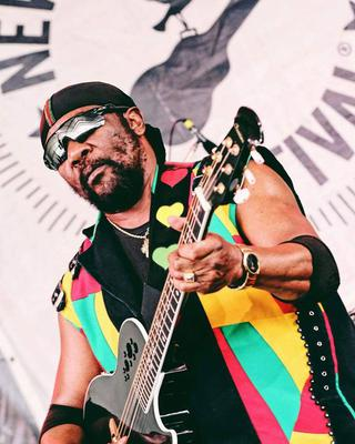 Toots Hibbert rocking the One Love Guitar Strap
